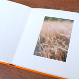 Custom album for professional photography mounted on museum-grade mats