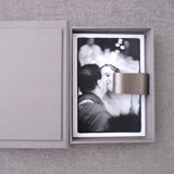 Image of couple in black & white with box